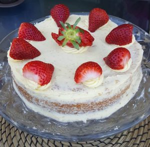 Decorated with buttercream icing and fresh strawberries